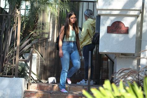 Addison Rae Waits In Her Socks Outside A Friends House In