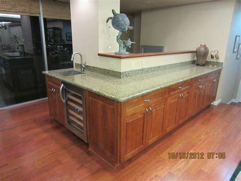 sunset cherry c c cabinets and granite