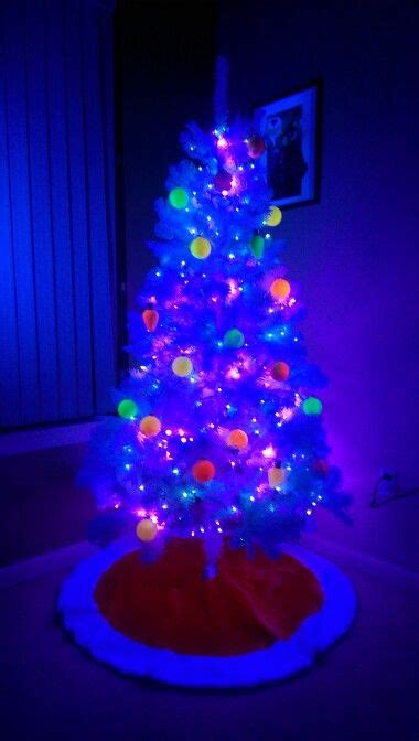 neon christmas lights blacklight tree 2 blacklights just outside view blue and purple string