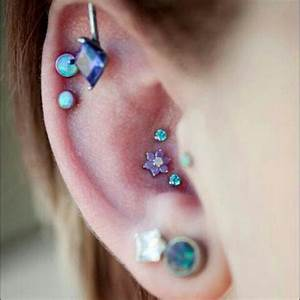 Triple conch piercing featuring a 14k White Gold flower ...
