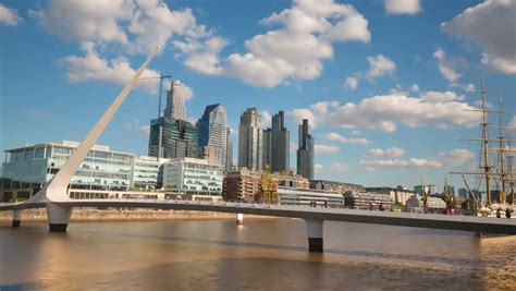 Once Building In Buenos Aires Arg by Puente De La Mujer A Modern Footbridge And Landmark Of
