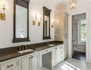 gray and gold bathroom with restoration hardware trumeau