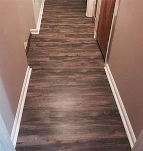 vinyl plank flooring and trim quarter round installed With parquet koval