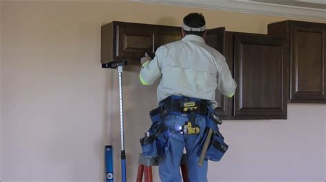 install kitchen wall cabinets  crown moldings