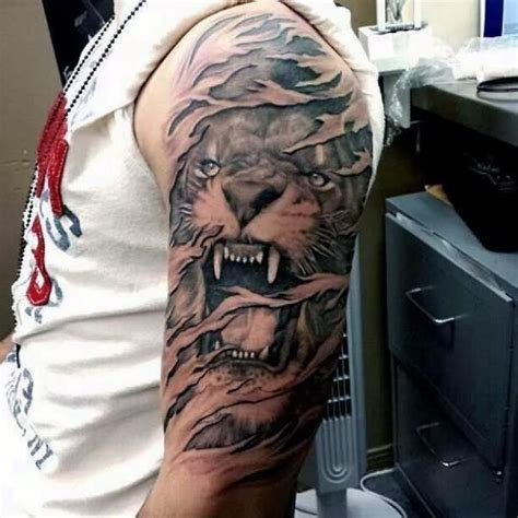 grey ink ripped skin lion tattoo   sleeve