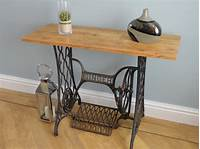 antique sewing machine table Sewing Machine Table made from a vintage cast-iron Singer