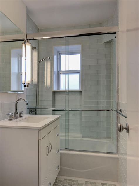 White Modern Bathroom by An All White Palette And Reflective Surfaces Give This New