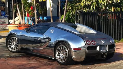 Bugatti has made some of the most coveted cars in history. Chrome Bugatti Veyron | South Beach | Exotic Cars on the ...