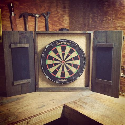Dart Board Cabinet With Engraving On The Outside, And