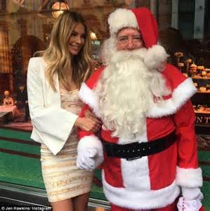 jennifer hawkins cuddles up to father christmas at myer s festive windows launch daily mail online