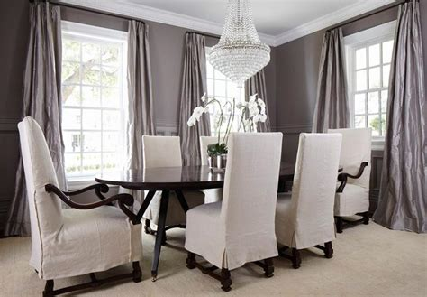 sophisticated gray dining room features dark oval dining