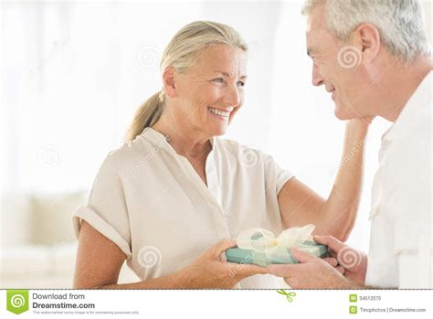 woman receiving gift  man  home royalty  stock