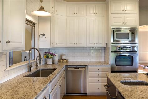 What To Do With White Kitchen Cabinets by Painting Kitchen Cabinets Before Or After Changing The