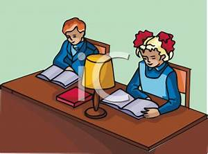 Clipart Picture of Two Children Studying at a Desk