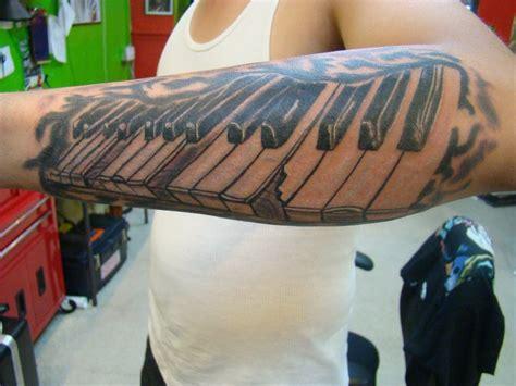 left arm piano keys tattoo