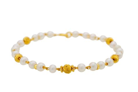 Buy Knotted Pearl Gold Bracelet  Gold Bracelets For Women. Ear Rings. Daughter Bracelet. Monogram Ankle Bracelets. Star Diamond. Mens Gold Watches. Hand Wound Watches. Gold Diamond Bands. Channel Set Rings