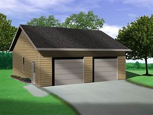 Vaulted Ceiling In This Two Car Garage Plan Allows For Auto Lift In One Bay