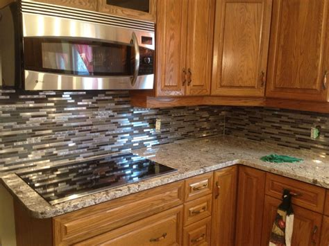 Granite Backsplash by Giallo Ornamental Granite With A Mosaic Backsplash