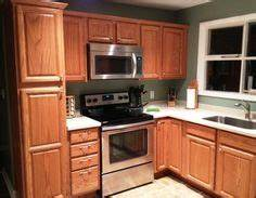 natural kraftmaid briarwood hickory beaded cabinetslove With kitchen cabinets lowes with tahoe stickers