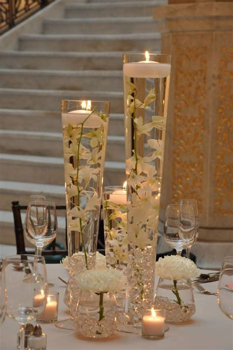 extensive white decorating table for this centerpiece is a dollarstore away very elegant