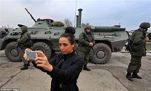 Shocking pictures show people in Crimea taking SELFIES ...