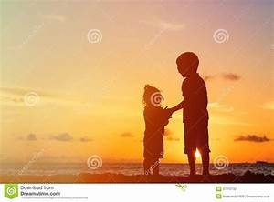 Little Boy And Girl Holding Hands At Sunset Stock Photo ...