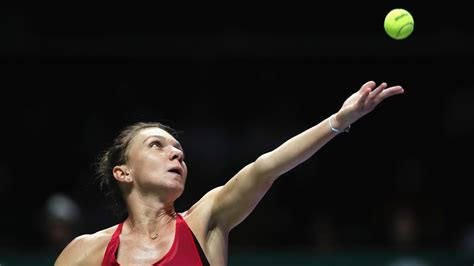 Caroline Wozniacki thrashes Simona Halep to advance at WTA Finals | Sport | The Guardian
