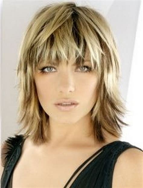 blonde medium length choppy shag haircut with wispy bangs