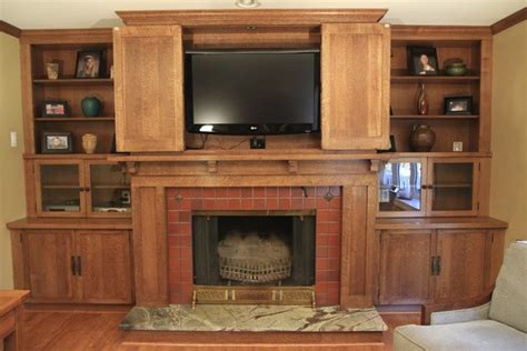 custom woodworking fireplace mantel with bookcases and television cabinet craftsman