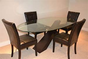 Oval glass dining room table interiors design for Oval glass dining room table