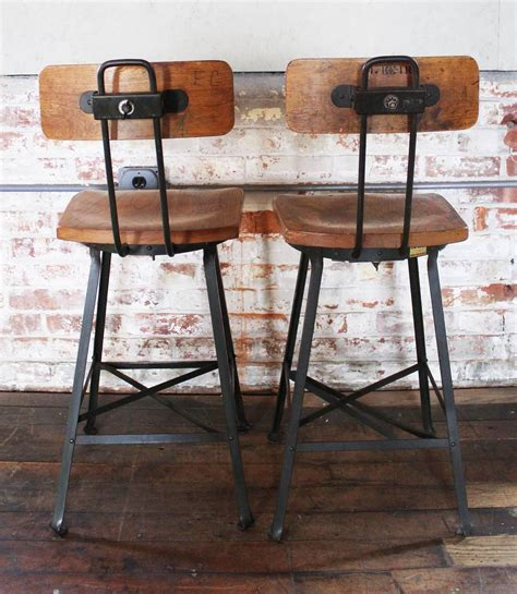 pair of vintage industrial wood and metal bar stools for