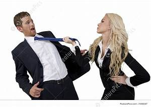Business People  Lady Pulling Tie Of Man