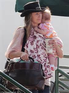 tnt makeup school mira sorvino juggles baby and a coffee in picture