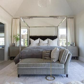 chrome canopy bed white and gray bedroom with beaded chandelier