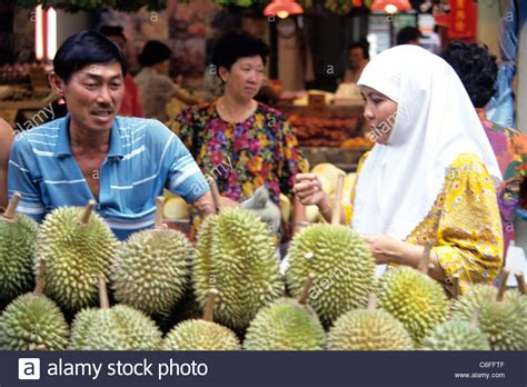 Muslim Woman In Burqa Shopping For Durians In Singapore