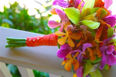 purple table runners bright tropical wedding flowers flowers