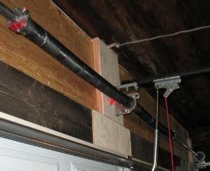how to tighten torsion on garage door adjusting garage door springs doors