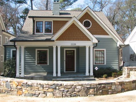 exterior craftsman style homes design ideas with gray wall siding and roadblock plus