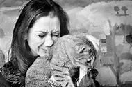 Sad Woman Holding Cat
