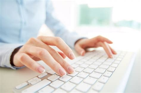 Close-up Of Employee With Computer Keyboard Photo