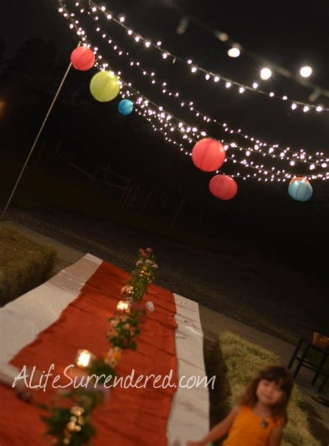 string lights and hang lanterns for summer outdoor