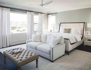 Ivory tufted headboard with brass and glass nightstands for End of bed sofa bench