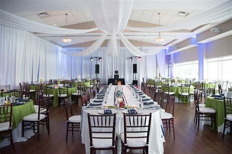 lime green and navy blue wedding reception with draping