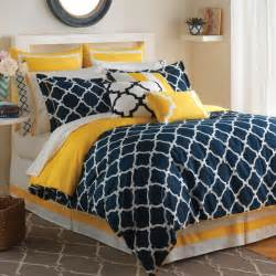 modern bedroom decoration with contemporary geometric blue and yellow comforter set and white