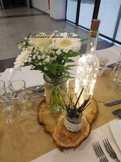 centre de table nature sur rondin de bois avec bouteille