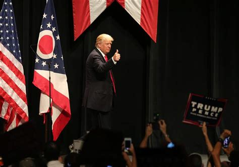 trump stage donald toledo react remarks republicans local stranahan sept appearance theater leaves during