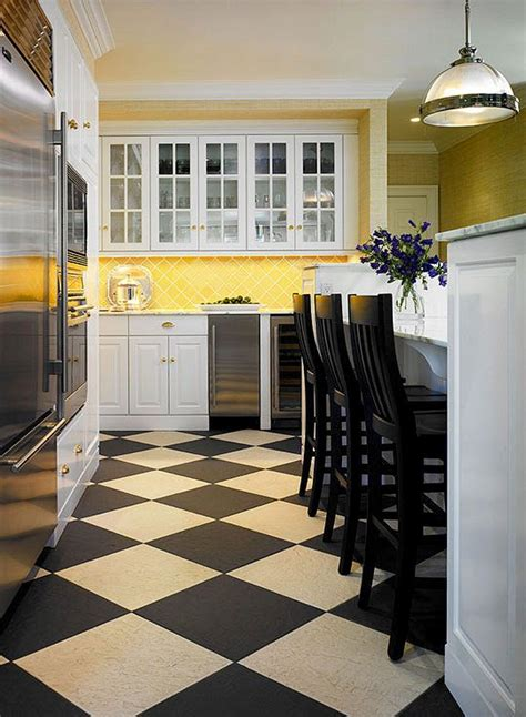 yellow kitchen floor warmed by yellow tiles on the backsplash and a black and 1218