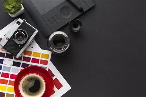 How will i know if my colors look good together? Top view of desk with coffee and color palette | Free Photo