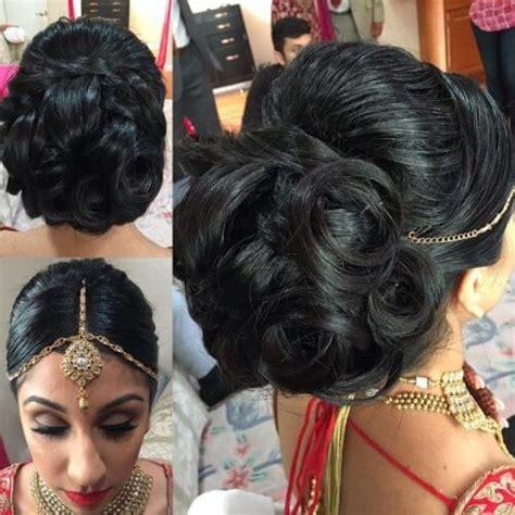 bridal juda hairstyle  maang tikka hair buns