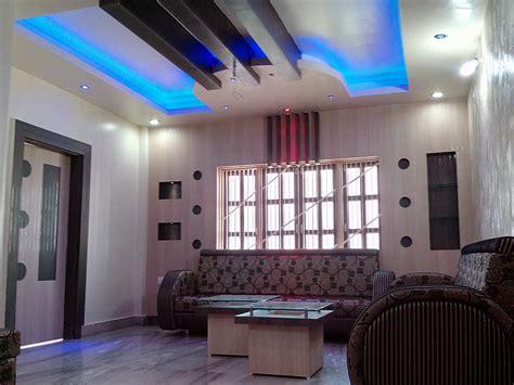 wooden plank  pop false ceiling design  living room gharexpert
